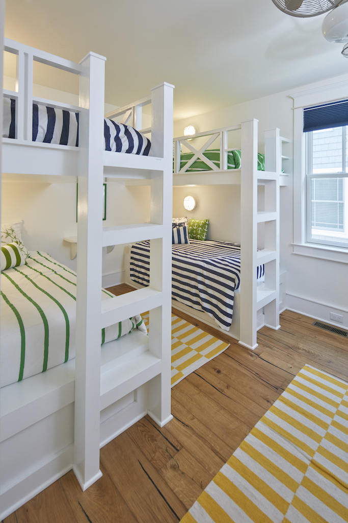 The Big Easy bunkbeds with bedspreads in bright colors