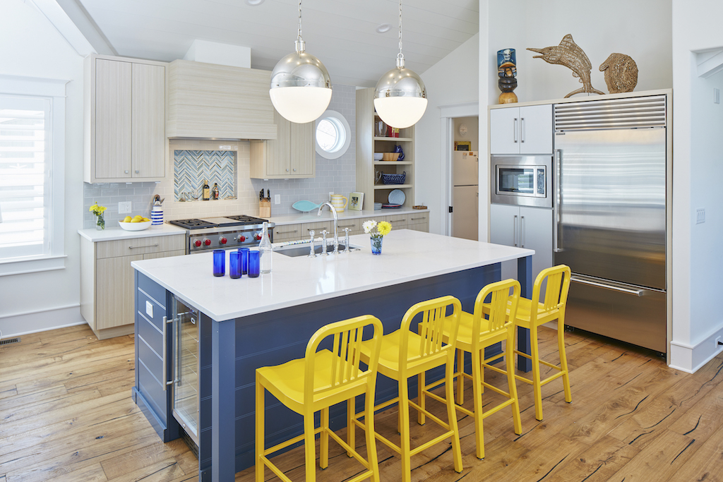 The Big Easy kitchen with yellow stools and blue island